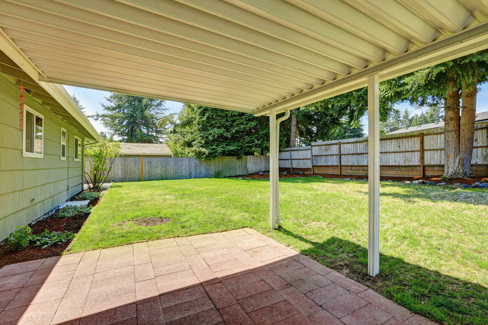 Covered,Backyard,Patio,With,Brick,Tile,Floor.